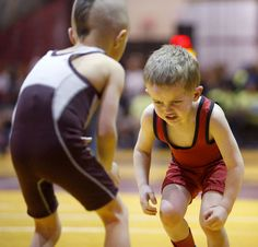 Noah Hansen, of Brookings, right, had his game face on as he squared off with Benjamin Wieman, of Madison, left, during their match Saturday at the State AAU Wrestling Tournament at the Barnett Center. The tournament concludes today. American News Photo by John Davis taken 4/2/2016