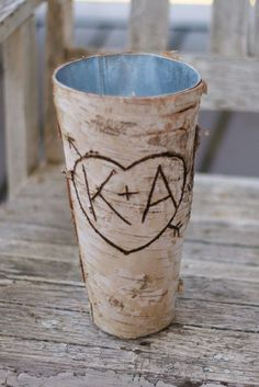 Rustic Chic Engraved Wood Birch Bark Centerpiece Vase (item E10609). $19.99, via Etsy.