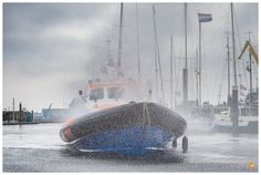 https://flic.kr/p/TgnnGb | Dorus Rijkers demonstrating her prewetting system | Lifeboat Dorus Rijkers demonstrating the prewetting system, during the national lifeboat day in Den Helder, the Netherlands. The prewetting system is used in case of operations on offshore fires, to protect the boat and crew from the heat.