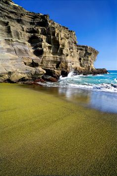 Green Sand Beach.   Puu Mahana Beach (Green Sand beach) is the spectacular erosion product of a volcanic cinder cone near South Point on the Big Island of Hawaii.