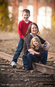 Image result for FAMILY OF THREE URBAN RAILROAD TRACKS