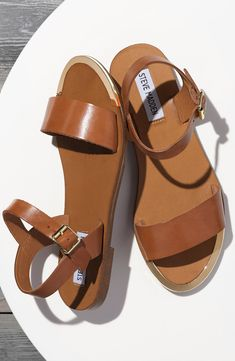 These go-to casual sandals are accented with polished goldtone hardware for a flash of modern glamour.