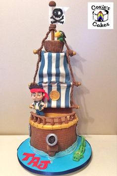 Jake and the Neverland Pirates 3 tier cake with Jake and Skully on board Bucky and the Tic Toc Croc swimming below.