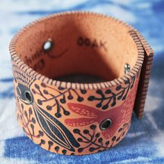 One of a kind leather cuff, handmade in Mexico. The freehand drawing on this cuff was made by me using a pyrography tool and the hares were stamped with pigment ink.  It was sealed with a wax salve. Geninne Zlatkis