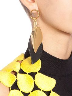 Leaf-shaped clip-on earrings in metal and leather