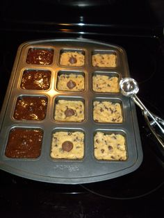 Used my pampered chef brownie pan for these! Choc. chip cookie on the bottom, hershey's kiss, and then brownie mix!