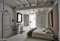 whats not to like-shutters, old doors, white washed beams and low European ceiling-sigh...