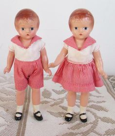 """These are Effanbee's Wee Patsy dolls, a boy and girl twin set. Many people think the boys' outfit is a girl's romper, but it was intended to make the little girl into a little boy. These two are all composition and only 6"""" tall."""