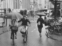 Couples - It was raining in a street near a canal in Amsterdam...