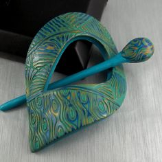 Peacock Inspired Shawl Pin / Scarf Pin / Hair Pin. $35.00, via Etsy.