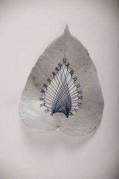 Hillary Fayle's meticulously stitched leaves take hours of patience and skill.