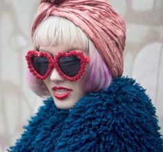 Pink turban and rose rimmed heart-shaped shades.
