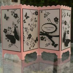 By Linda Parker: 11 by 6 cardstock scored @ 2 3/4, 5 1/2, & 8 1/4. Top edge is scalloped border punch & bottom is decorative label punch.