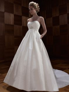 CB Couture - Empire A-Line Silk Shantung gown with a strapless soft sweetheart neckline. Beaded applique on band at waist is embellished with Swarovski crystals, crystal sequins, rhinestones, and Freshwater pearls. Matching fabric buttons line the top of the bodice.