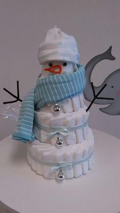 4 Tier Snowman Diaper Cake!! - http://www.babyshower-decorations.com/4-tier-snowman-diaper-cake.html