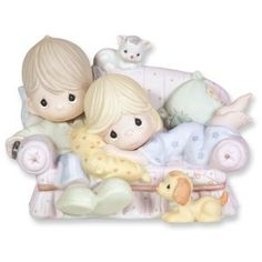 Precious Moments Couple on Couch Figurine-this looks like me, my husband, Bailey, and Daisy! We used to watch tv like this!