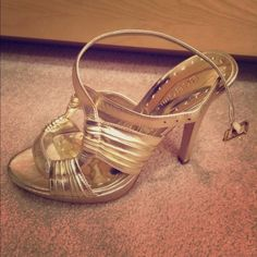 BCBGirls gold, strapped heels! Gold, strapped heels, worn twice! Straps cross once around the ankle. Heel height is 4/4.5 inches. BCBGirls Shoes Heels