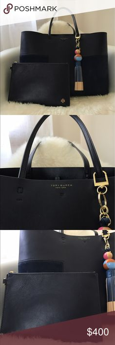 """Tory Burch Tote. Bag charm is sold separately. A study in luxurious minimalism: Unlined, resin-backed leather gives our Block-T Tote a raw-meets-refined feel. One of Tory's favorite styles, it can easily hold a full day's essentials, with enough space for a 15"""" laptop and an extra pair of shoes. The bag has a removable zip pouch for your phone and other small belongings, and a tonal or contrast-color interior. Finished with a polished gold toggle closure, it's super-versatile and modern —…"""