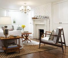 What a great idea this is. Paint brick white and pick up an old, glam fireplace mantle from your local salvage store.