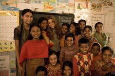 UNICEF Goodwill Ambassador Shakira (centre) stands with a group of smiling students at a UNICEF-supported centre in Rajshahi City in northern Bangladesh. The centre serves urban working children.  © UNICEF/NYHQ2007-2056/Shehzad Noorani - http://www.unicef.org