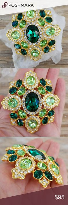 Kenneth Jay Lane   KJL Emerald Rhinestone Brooch Kenneth Jay Lane   KJL Signed Emerald rhinestone brooch/pendant. Gorgeous Emerald Green and Citrine rhinestones accented by Clear rhinestones. Gold tone metal. Brooch can also be worn as a pendant on a necklace.  Brooch is in excellent condition, it is new without box. Kenneth Jay Lane Jewelry Brooches