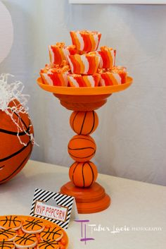 I made the dessert stands by sticking foam basketballs onto dowel rods and gluing them into wooden discs.   - See more at: http://partylikepaula.com/2012/09/basketball-birthday-party.html#sthash.OILBRhz4.dpuf