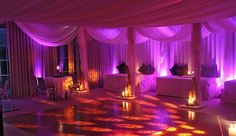 Contemporary Ivory drapes with bespoke beduin style booths with pink lighting and candle features.