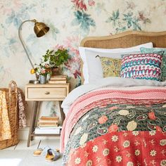 Loaf's retro Campaign side table and rattan Margot bed in this cosy floral bedroom
