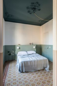 After a fire tragically wreaked severe damage to the interior, CaSA refurbished the Klinker family apartment in Barcelona with clever use of materials. Decor, Built In Furniture, Striped Room, Interior, Apartment Design, Mint Walls, Home Decor, Interior Design, Barcelona Apartment