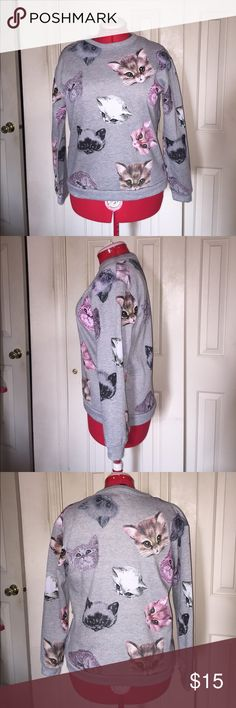 """XXI Forever 21 Cat Motif Sweatshirt XXI Forever 21 Cat Motif Sweatshirt EUC Size: Small Color: Grey Measurements when Flat: Bust: 21"""" Waist: 19"""" Length: 24""""  Fabric Composition: 63% Cotton 37% Polyester *In excellent condition. No pilling or stretching. Forever 21 Tops Sweatshirts & Hoodies"""