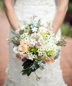 ABSOLUTELY GORGEOUS pastel bridal bouquet in shades of peach, pink, blush, white, ivory, light blue, grey, and light green. Loosely arranged with an organic and romantic feel, this bouquet features roses, stephanotis, tweedia, star of Bethlehem, scabiosa, berzillia, and more. Photo: Nicole Haley Photography.