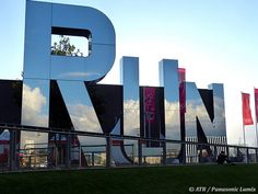 Towering mirrored letters spell RUN outside the Copper Box, venue for handball on Olympic Park. (ATR/Panasonic Lumix) Add Around The Rings on www.Twitter.com/AroundTheRings & www.Facebook.com/AroundTheRings for the latest info on the #Olympics.