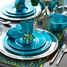 Peacock Christmas Table Decor...I love these colors. This would be so pretty with a tree decorated in peacock colors