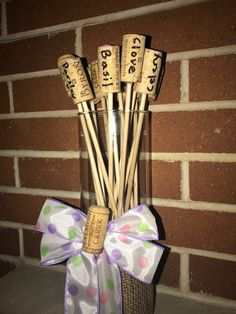 Property of Personalized Traditions - Wine Cork Garden Stakes in a glass vase