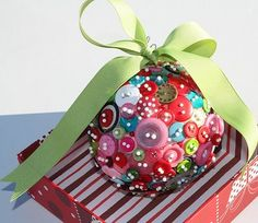 Christmas balls made with styrofoam balls, buttons and pins.  Great gifts for the kids to make!