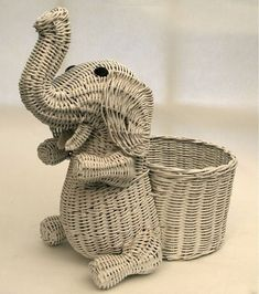 Most popular tags for this image include: animal, basket, elephant, white and…