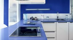 20 Best DIY Kitchen Upgrades - Paint the walls. Kitchens tend to have a relatively small area of visual wall space, so don't be afraid to go bold! Blue Countertops, Kitchen Countertops, Cuisines Diy, Cuisines Design, Diy Kitchen, Kitchen Decor, Kitchen Modern, Kitchen Ideas, Blue Kitchen Interior