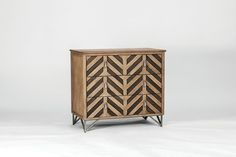 Our wood chevron chest features a herringbone pattern on the drawer fronts. A metal base finished in Honey Oak and Havana Oak with antique nickel accents.