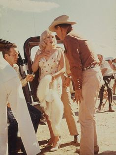 Marilyn rehearsing a scene with Clark Gable and Montgomery Clift during the filming of The Misfits, 1960.
