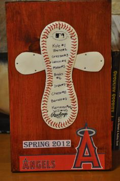 Baseball Cross plaque- gift for coach.  Cut the baseball on the outside of the laces. Pull both parts off of baseball. The smaller part will go behind the laced part. You may have to soak the laced part in hot water to soften  it enough to stretch out flat. Nail it down onto a painted or stained board. Put a hanger on the back.