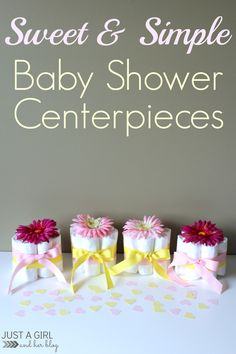 Super sweet and simple baby shower centerpiece made with diapers, ribbon, and a faux flower! Adorable! | Just a Girl and Her Blog