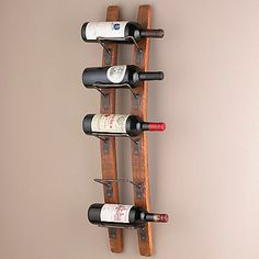 Barrel Stave Wall Wine Rack at Wine Enthusiast - $99.95 very mixed reviews, wondering if I could find metal holders  and do with snow or water skis.