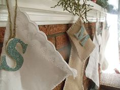 I have names engraved on our stocking holders so I haven't had them embroiderd on stockings so I like the idea of just the inital hanging.