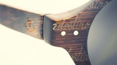 Beautiful engraving on a wooden eywear frame.
