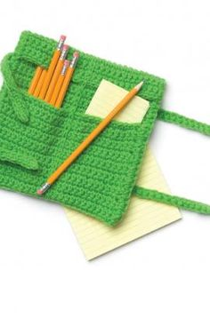 "Roll-Up Pencil Case - Organize your favorite pens and pencils in this easy to crochet case. This clever accessory works well for your crochet hooks, too! RHSS: 1 ball Spring Green. Crochet Hook: G7/4mm Pencil Case is 7"" wide x 9½"" long. free pdf from RH"