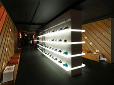 What an awesome way to display shoes products. The brightly lit shelf and dark ambient lighting really make the shoes pop as if displayed in a museum. I'm fascinated with bright lights and neon right now. Maybe my future office with have both.