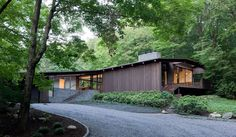 This mid century reimagined home by Joel Sanders Architect and Balmori Associates is a blending of new and old
