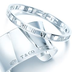 Your perfect mix? Atlas® cuff and Tiffany 1837™ bangle in sterling silver.