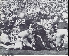 Oregon fullback Dave Powell dives forward in a 1958 football game. From the 1959 Oregana (University of Oregon yearbook). www.CampusAttic.com