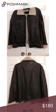 Men's leather jacket Men's dark brown leather jacket with faux sheep fur on the inside. With zipper closing Jackets & Coats